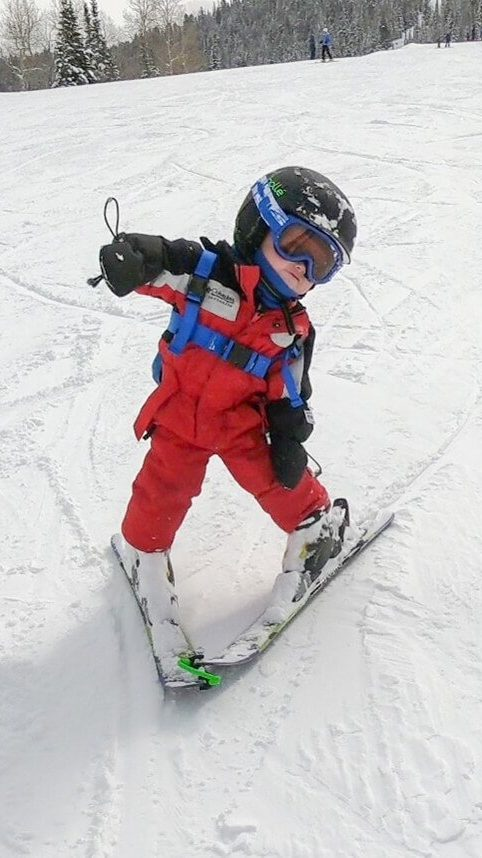 toddler skiing alone