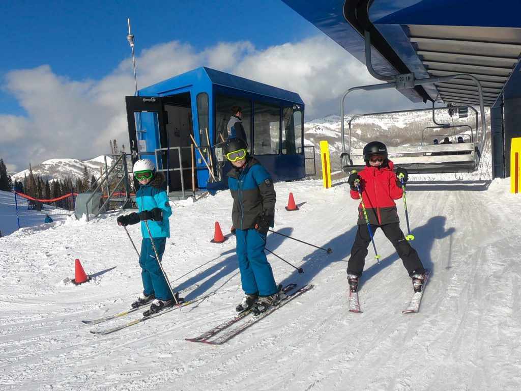 kids getting off chairlift
