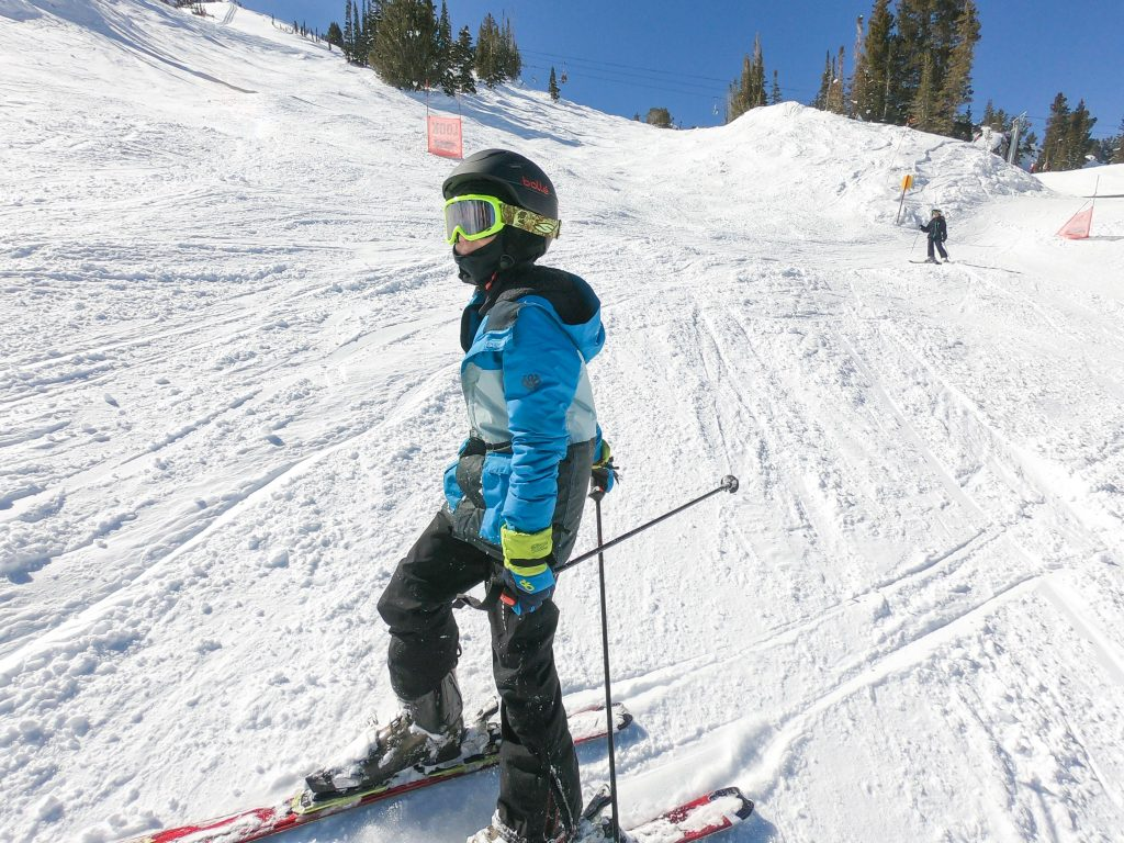 boy skiing wearing balaclava