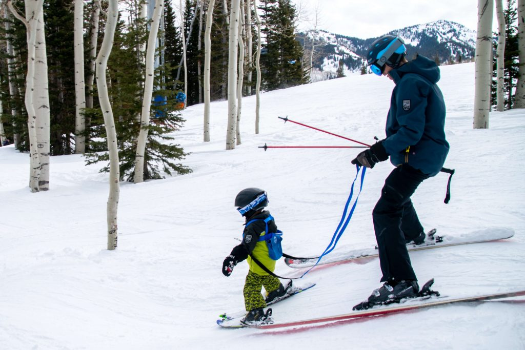 toddler with ski harness