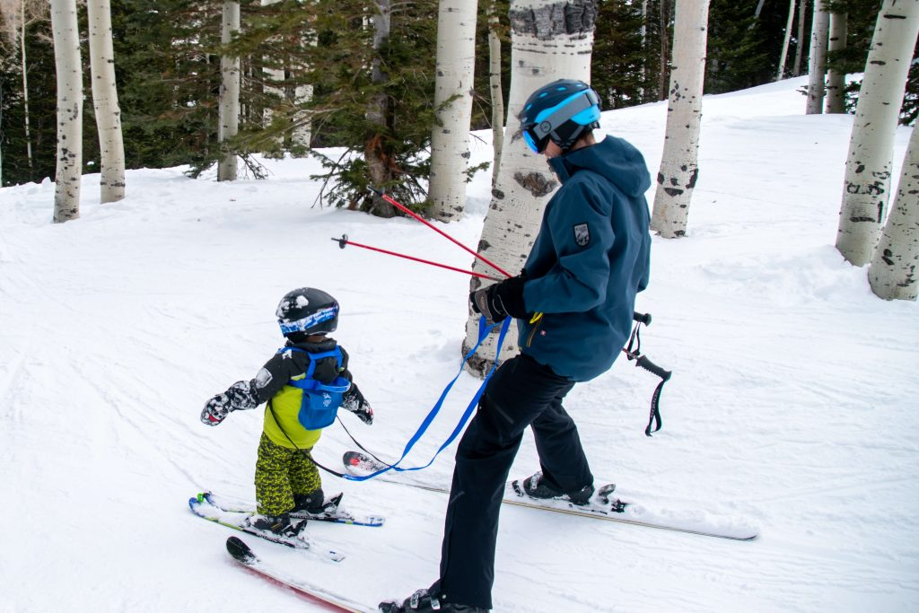 little boy using a ski harness