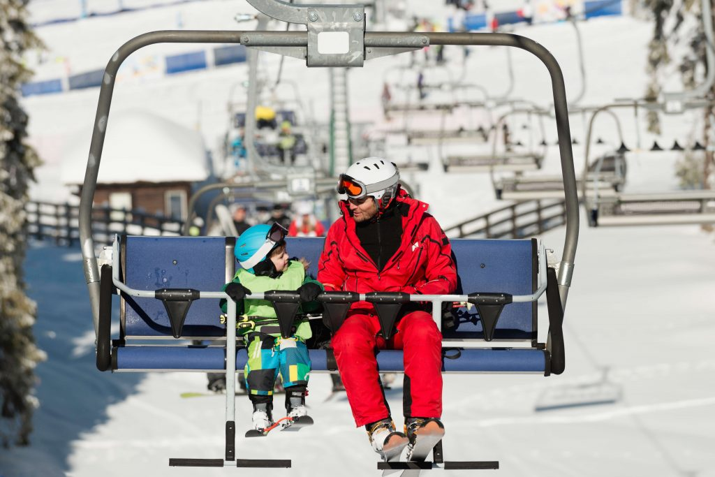 kids skiing chairlift