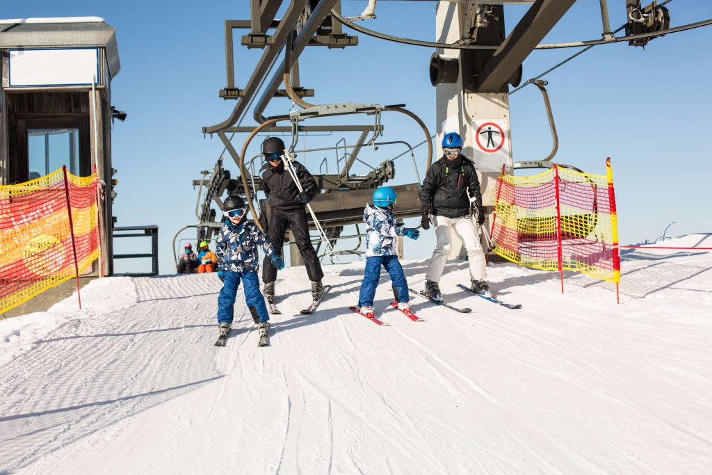 family getting off chairlift