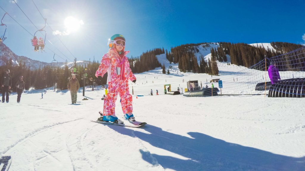 girl skiing snowsuit