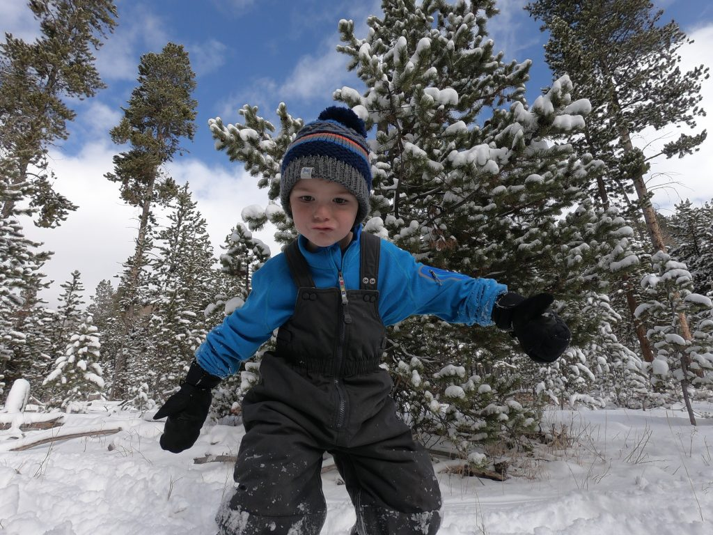 boy Playing in the snow with mittens