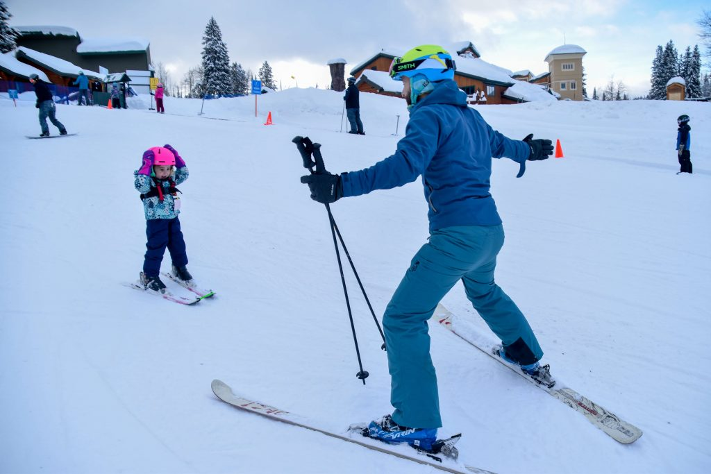 little girl learning how to ski