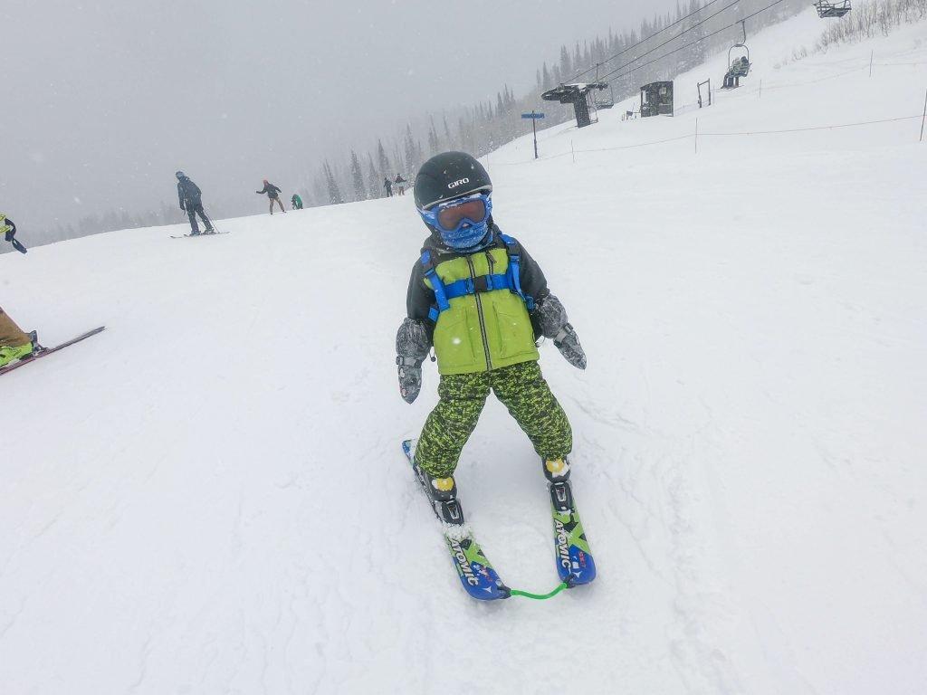 toddler in ski harness