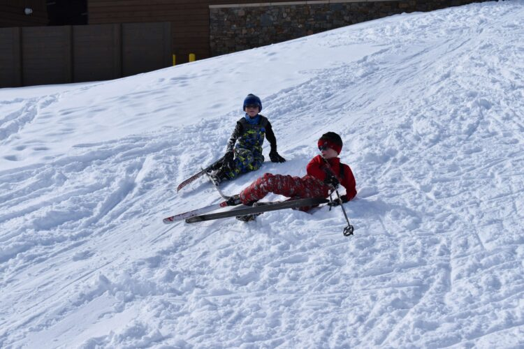 cross country skiing with kids falling down
