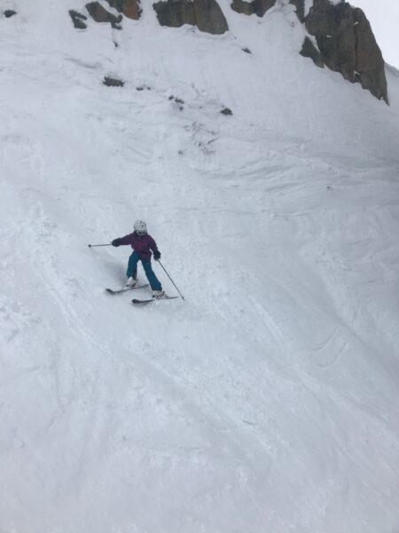 teen girl skiing steep